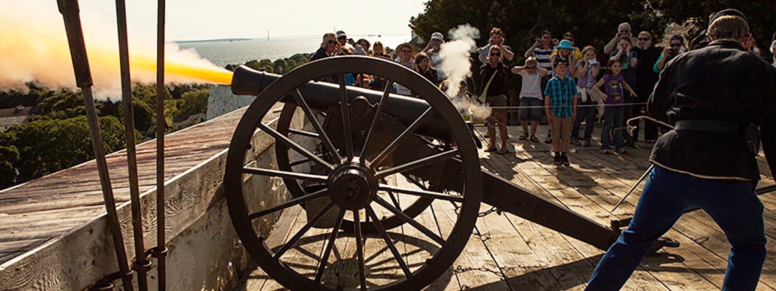 Photo of a cannon being fired at Fort Mackinac on Mackinac Island